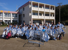 Students dressed to act as human reflectors. The radio-wave reflectors are in the foreground.