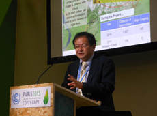 Kenichi Shishido presenting the JICA-JAXA tropical forest monitoring system at COP 21