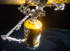 KOUNOTORI 5 captured by the robotic arm (courtesy of JAXA/NASA)