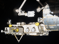 Small satellites being moved from Kibo to space by Kibo's robotic arm (courtesy of JAXA/NASA)