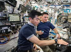 Astronaut Yui (left) training on the ISS for the docking of KOUNOTORI5  (courtesy of JAXA/NASA)