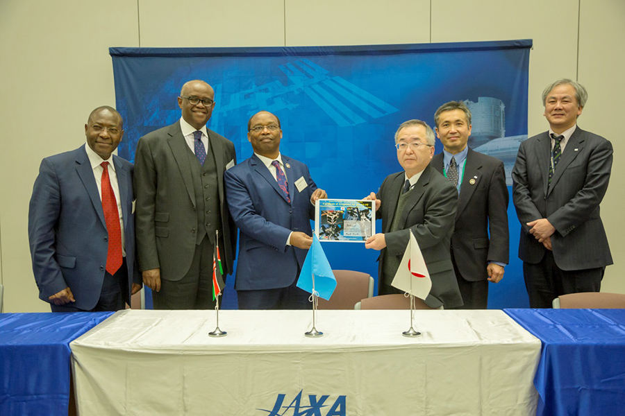 Officials from Kenya receiving the handover acknowledgement from JAXA Officials